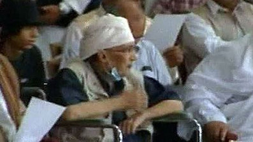 Libyan man convicted in the 1988 bombing of a Pan Am plane over Lockerbie, Scotland, attended a rally in Tripoli in support of Muammar Qaddafi, according to Libya's state TV — another sign of defiance by the Qaddafi regime.