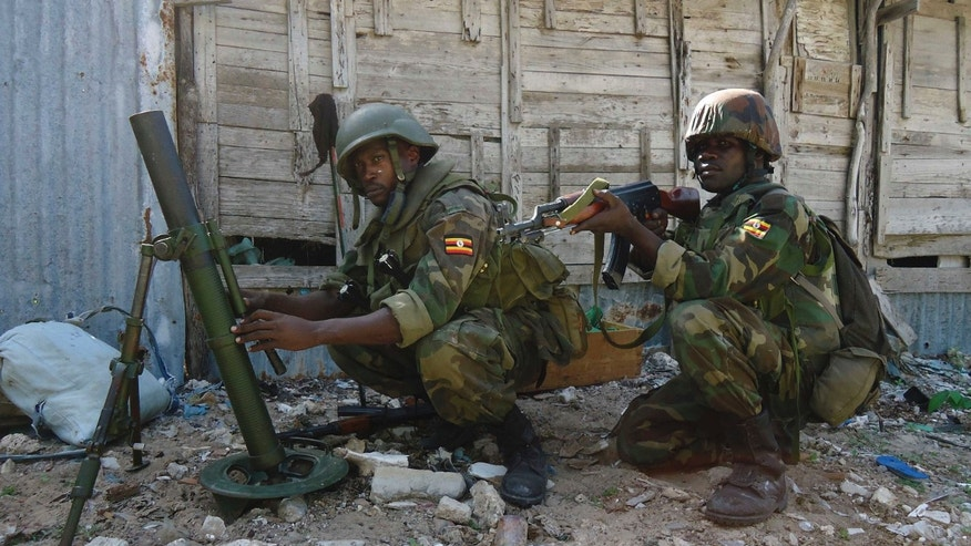 African Union troops in defence in Yaaqshid district of Mogadishu, Somalia, Thursday, July 28, 2011. The government and African Union Peacekeeping troops launched attack and seized al-Shabaab bases in Wardhiigley, Yaaqshid and Boondere districts of Mogadishu.