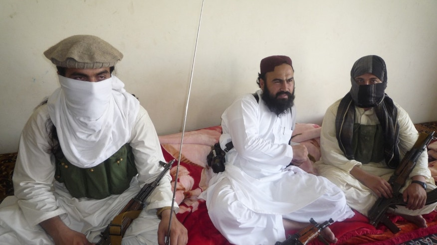 July 28, 2011: Taliban No 2 commander Waliur Rehman, centre , flanked by militants, talks to the Associated Press in Shawal area of South Waziristan along the Afghanistan border in Pakistan. The Pakistani Taliban has custody of two kidnapped Swiss tourists, but is willing to free them if the U.S. releases a female Pakistani scientist convicted of trying to kill Americans, Rehman told The Associated Press. The couple's identity has not been disclosed.