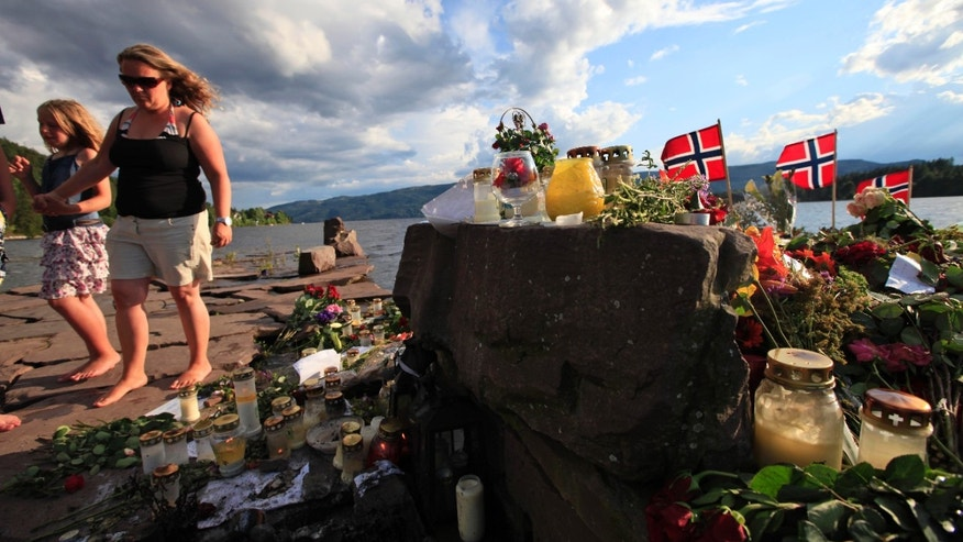 Flowers and tributes for the victims are seen in Sundvollen, close to Utoya island, where gunman Anders Behring Breivik killed at least 68 people, near Oslo, Norway, Thursday July 28, 2011.