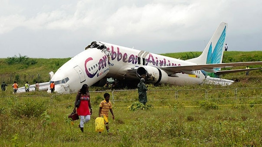July 30: The broken fuselage of a Caribbean Airlines' Boeing 737-800 is seen after it crashed at the end of the runway at Cheddi Jagan International Airport in Timehri, Guyana.