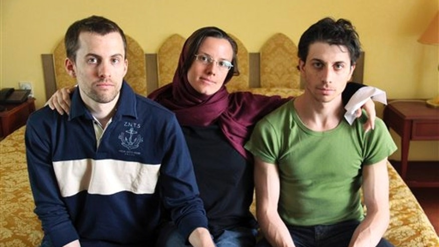 In this May 20, 2010 file photo, American hikers Shane Bauer, left, Sarah Shourd, center, and Josh Fattal, sit at the Esteghlal Hotel in Tehran, Iran.
