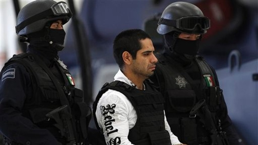 "July 31: Jose Antonio Acosta Hernandez, 33, is presented to the media by federal police officers in Mexico City. According to federal officials, Acosta, nicknamed ""El Diego,"" is a key drug cartel figure, who acknowledged ordering 1,500 killings. He is also a suspect in last year's slaying of a U.S. consulate employee near a border crossing in Ciudad Juarez."