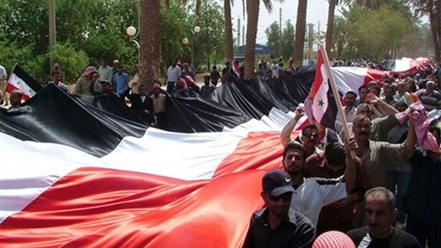 July 28: In this photo released by the Syrian official news agency SANA, Syrian pro-government supporters carry a giant national flag during a rally in the eastern province of Deir el-Zour. A global campaigning organization said Thursday that one person disappears in Syria every hour and that almost 3,000 people have gone missing since the start of the uprising against President Bashar Assad more than four months ago.