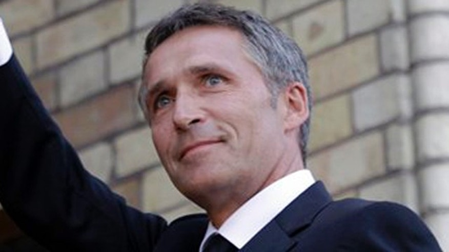 Norway's Prime Minister Jens Stoltenberg waves to supporters as he arrives for a memorial to honor the victims of the July 22 bombing and shooting massacre, at the parliament in Oslo, Monday, Aug. 1, 2011.