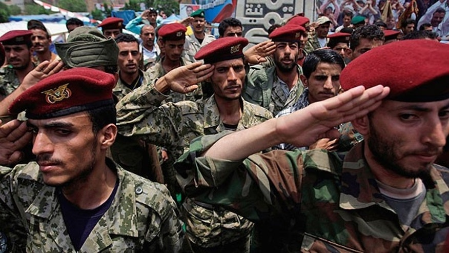 July 31: Defected soldiers salute during a protest demanding the resignation of Yemen's President Ali Abdullah Saleh in Sanaa, Yemen.