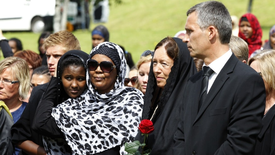 Norway's Prime Minister Jens Stoltenberg, right, and mourners attend the funeral ceremony of Mona Abdinur, 18, who was killed in the Friday, July 22 attack on the island of Utoya, Oslo, Norway, Tuesday, Aug. 2, 2011.