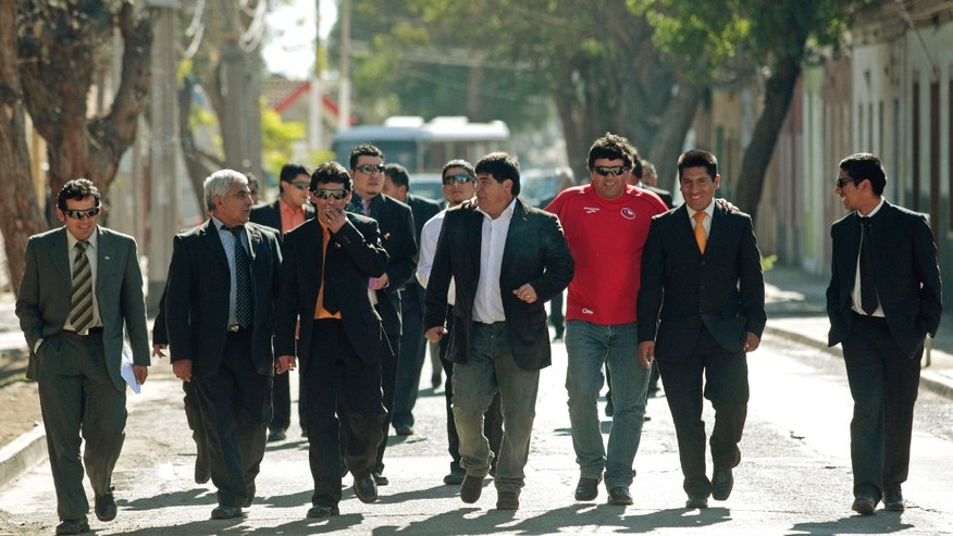 Former trapped miners, from left, Victor Zamora, Omar Reigadas, Claudio Yanez, Pedro Cortez, Carlos Bugueno, Esteban Rojas, Samuel Avalos, Carlos Mamani and Jimmy Sanchez arrive to attend a Mass marking the first anniversary of the San Jose mine collapse in Copiapo, Chile, Friday Aug. 5, 2011. The 33 miners survived 69 days, 700 feet deep after an unprecedented and dramatic Oct. 13, 2010 rescue.