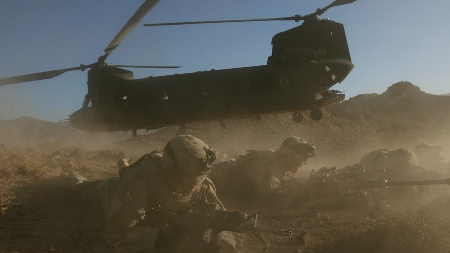 U.S. soldiers from the 2nd Brigade, 87th Infantry Regiment, 10th Mountain Division, secure the area   after existing a Chinoonk helicopter, Helmand Province, southern  Afghanistan, in this  Sunday, June 18, 2006 file photo. Insurgents apparently shot down a U.S. military helicopter Saturday Aug. 6, 2011 similar to this one shown during fighting in eastern Afghanistan, killing 30 Americans, most of them belonging to the same elite Navy SEALs unit that killed Usama bin Laden, as well as seven Afghan commandos, U.S. officials said.