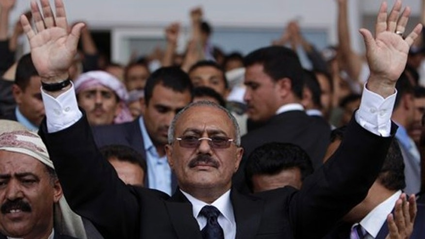 FILE - In this April 15, 2011 file photo, Yemeni President Ali Abdullah Saleh waves to his supporters, not pictured, during a rally in Sanaa,Yemen.