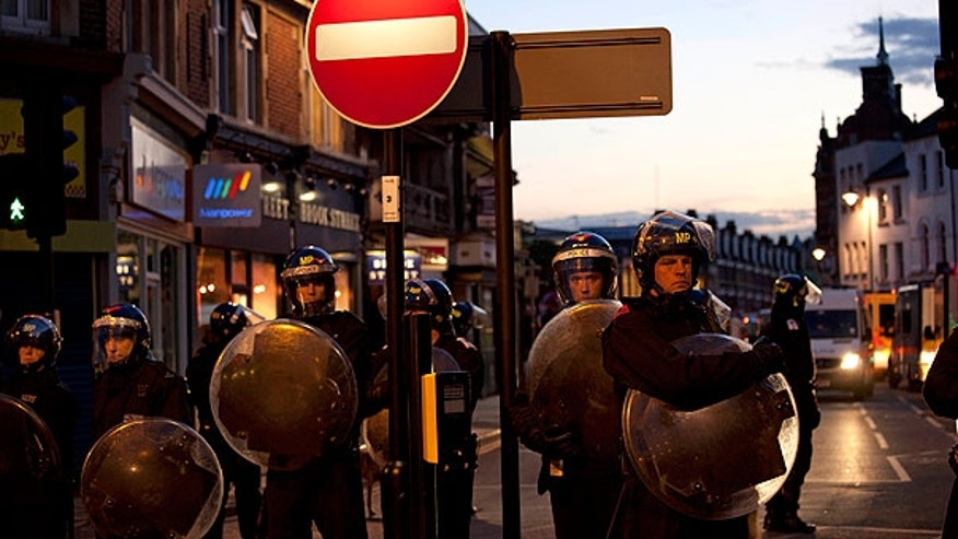 Aug. 7: Police cordon off an area during unrest in Enfield, North London. New unrest erupted on north London's streets late Sunday, a day after rioting and looting in a deprived area amid community anger over a fatal police shooting.