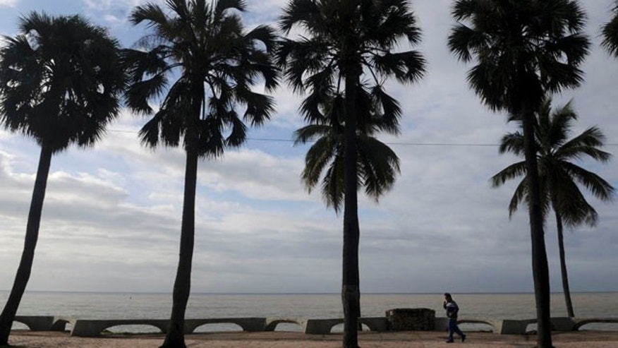 A man exercises at the Santo Domingo waterfront, the Dominican Republic, Wednesday Aug. 3, 2010.