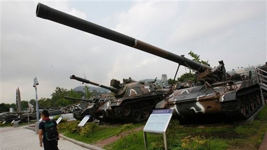 Aug. 10: A man walks past armored vehicles at the Korean War Memorial Museum in Seoul, South Korea. South Korean marines returned fire Wednesday after North Korea launched artillery shells into waters near the disputed maritime line that separates the two rivals, South Korean defense officials said.
