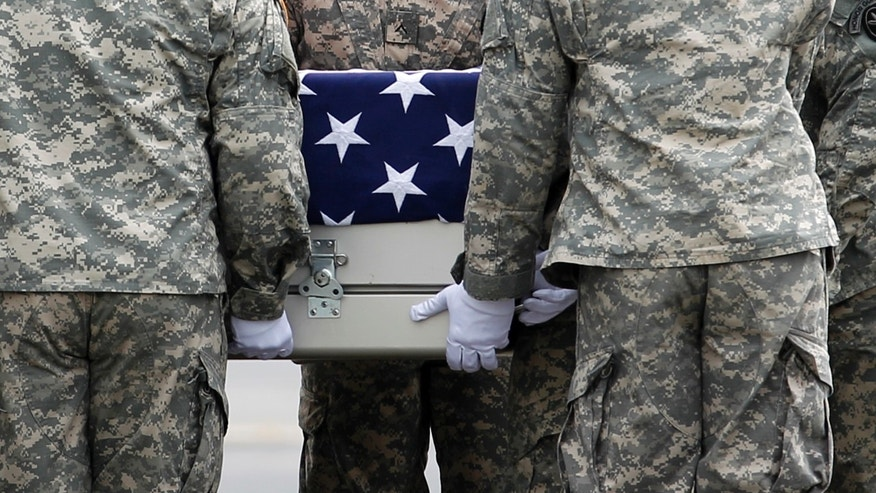 An Army carry team carries the transfer case containing the remains of Army Staff Sgt. Michael J. García of Bossier City, La. upon arrival at Dover Air Force Base, Del. on Wednesday, July 6, 2011. The Department of Defense announced the death of García who was supporting Operation Enduring Freedom in Afghanistan.(AP Photo/José Luis Magaña)