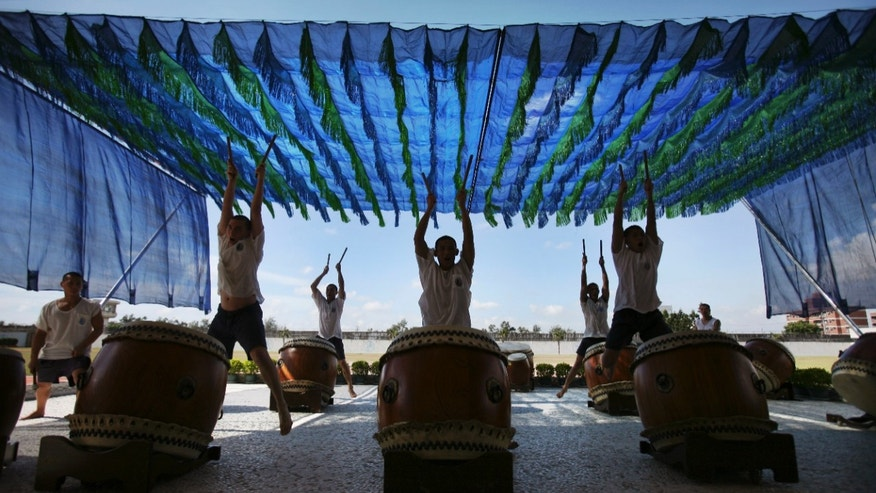 June 14: Young convicts practice Chinese style drum beats in the Changhua prison, in Changhua central Taiwan. Taiwan's U-Theatre Ensemble of drummers and Chinese operatic dancers leverage the spirituality of Zen Buddhism and Tai Chi Chuan exercises to try to instill a new sense of equanimity among the young convicts, most of whom have violence tinged-records mixed with serious drug abuse.