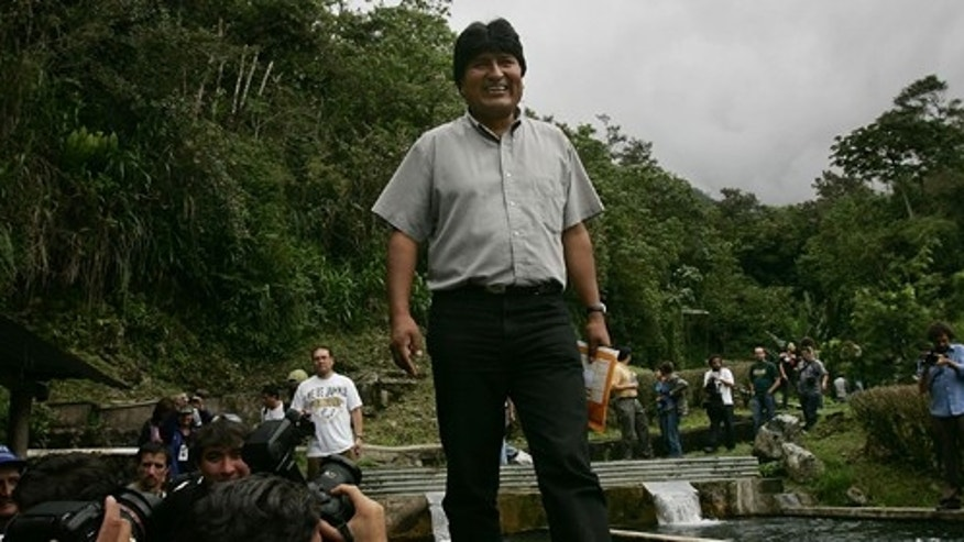 INCACHACA, BOLIVIA - DECEMBER 17:  Bolivian Presidential Candidate Evo Morales walks beside a trout pond while on his way to Chapare December 17, 2005 in Incachaca, Bolivia. Bolivia, one of South America's poorest countries, is about to face a crucial election with leftist candidate Evo Morales leading the field. Morales, a one time coca farmer and union leader, is leading in the polls for the presidential election on December 18.  Washington is paying close attention to the race as fears grow of yet another leftist government.  (Photo by Spencer Platt/Getty Images)