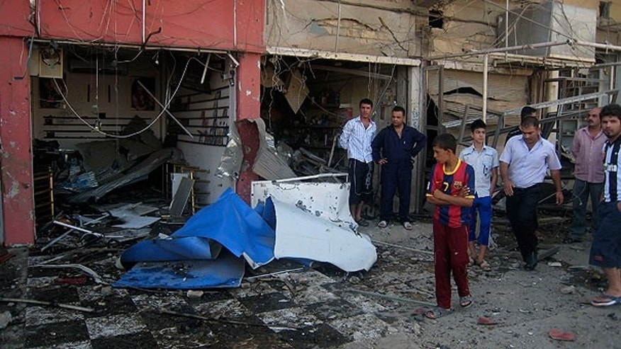 Aug. 15: Iraqis inspect the site of a bombing in Kirkuk, Iraq.