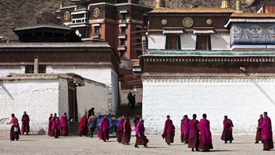 In this photo taken on Sunday, Feb. 22, 2009, Tibetan monks hang out at the Labrang monastery in Xiahe, Gansu province, China. Chinese tourism officials said Friday, Aug. 12, 2011,  that foreigners have been barred from a county in northwestern China, with activists saying security in the area has been stepped up ahead of an expected visit by a government-appointed Tibetan religious leader.