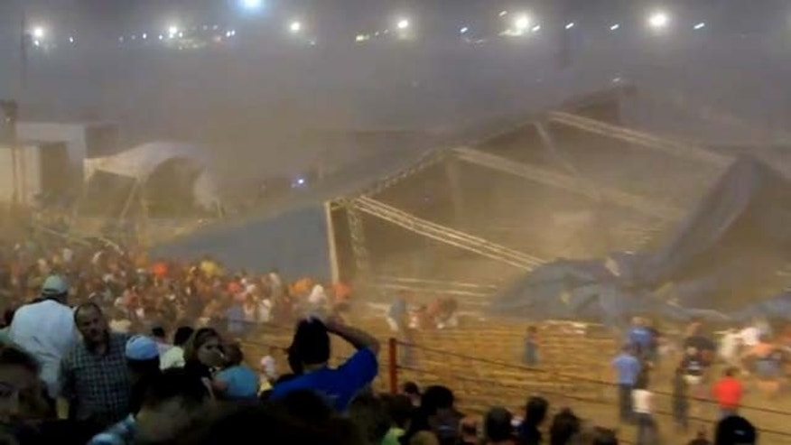 In this Saturday, Aug. 13, 2011 frame grab from video provided by Jessica Silas, a stage collapses at the Indiana State Fair, killing five and injuring dozens of fans waiting for the country band Sugarland to perform, in Indianapolis. (AP Photo/Jessica Silas)
