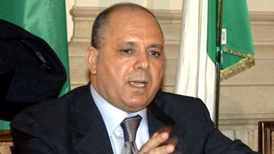 Libyan Interior Minister Nassr al-Mabrouk Abdullah gestures during a press conference  in Rome, Friday, in this Nov. 25, 2005 file photo.
