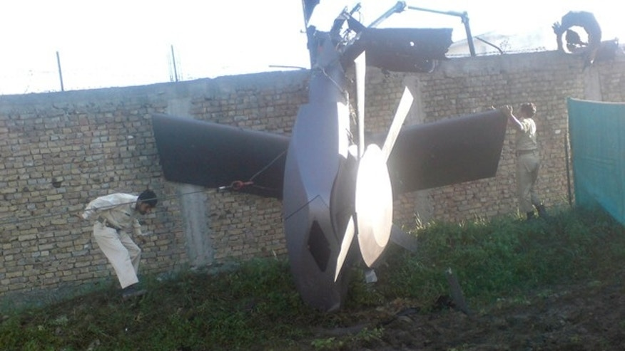 Part of a damaged helicopter is seen lying near the compound after U.S. Navy SEAL commandos killed al Qaeda leader Osama bin Laden in Abbottabad, May  2, 2011. Bin Laden was killed in the U.S. special forces assault on the Pakistani compound, then quickly buried at sea, in a dramatic end to the long manhunt for the al Qaeda leader who had been the guiding star of global terrorism. Picture taken May 2, 2011.   REUTERS/Stringer   (PAKISTAN - Tags: CRIME LAW POLITICS CIVIL UNREST IMAGES OF THE DAY)