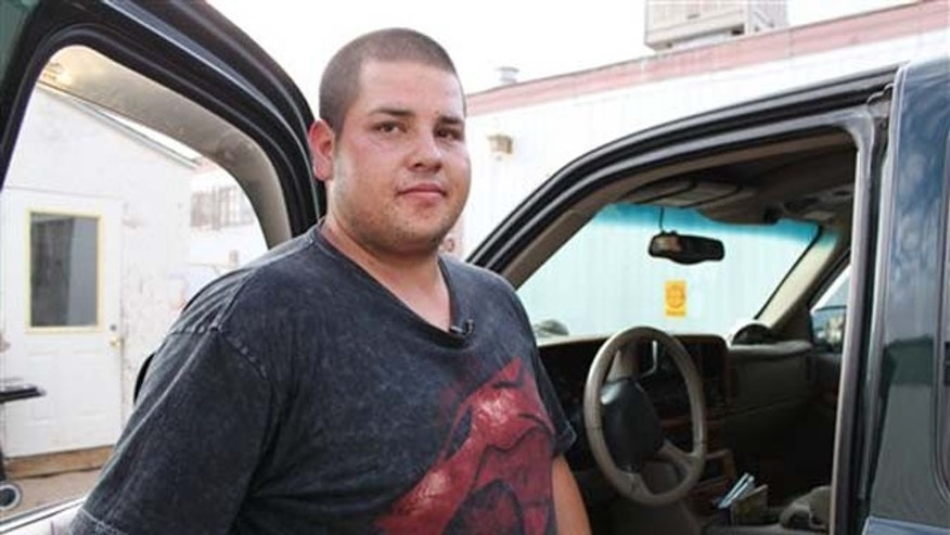 Aug. 16, 2011: Antonio Díaz Chacón stands next to his truck while talking to reporters about his efforts to save a 6-year-old girl who was abducted during an interview in front of his home in Albuquerque, N.M.