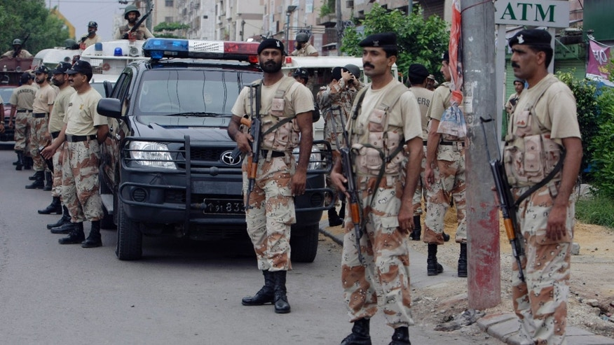 August 24: Pakistani security personnel visit a troubled area during a crackdown operation against target killers and the extortion mafia in Karachi, Pakistan. Over one hundred people lost their lives in the past week in result of a fresh wave of violence which crippled the Pakistan's largest city of Karachi.