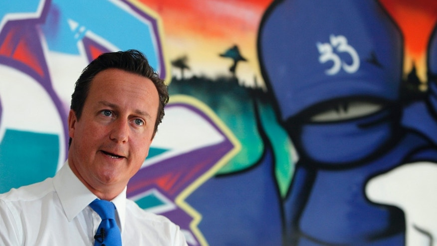 "August 15: Britain's Prime Minister David Cameron speaks at a youth center in Witney, his Parliamentary district in southern England. Britain must confront its ""slow-motion moral collapse"" Cameron declared following four days of riots that left five people dead, thousands facing criminal charges and at least 200 million pounds ($326 million) in property losses."
