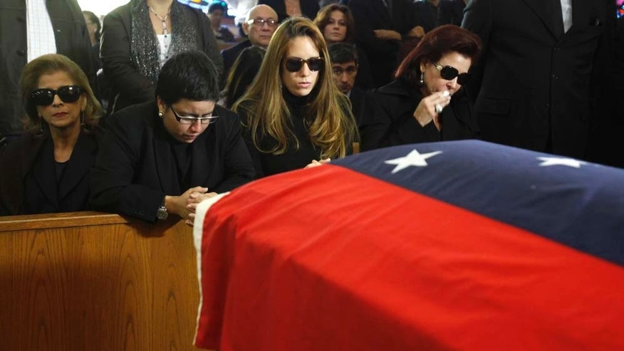 during a funeral mass for the former Venezuelan president Carlos Andres Perez at the St. Thomas the Apostle Church in Miami, Wednesday, Dec. 29, 2010. Perez died Saturday at age 88. (AP Photo/Lynne Sladky)