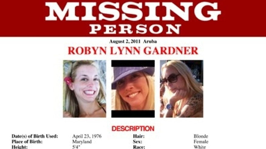 This missing person flyer released by the FBI requests information on Robyn Gardner, an American who went missing after she traveled to Aruba with Gary Giordano on July 31, 2011. He reported her missing two days later, saying she disappeared while the two were snorkeling.
