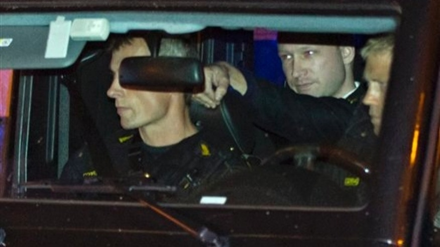 Aug. 19: Terror-charged Anders Behring Breivik arrives in the back of a police car at the court in Oslo. (AP)