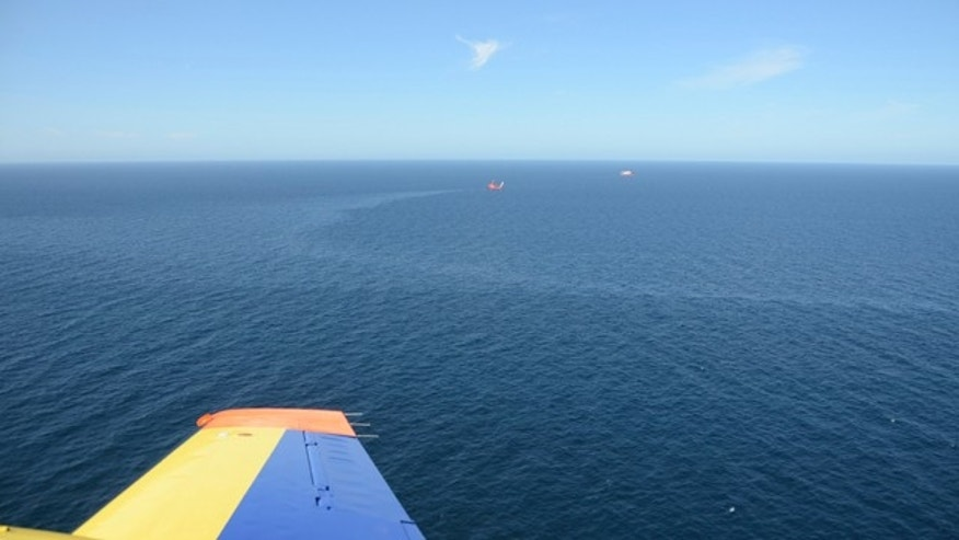 Aug. 17, 2011: In this image released by Scotland's government marine surveillance agency, a sheen of leaked oil can be seen off the east coast of the country. Royal Dutch Shell has shut down the main leak at one of its North Sea oil rigs but struggled Tuesday to repair a secondary spill in a hard to reach part of the ocean floor.