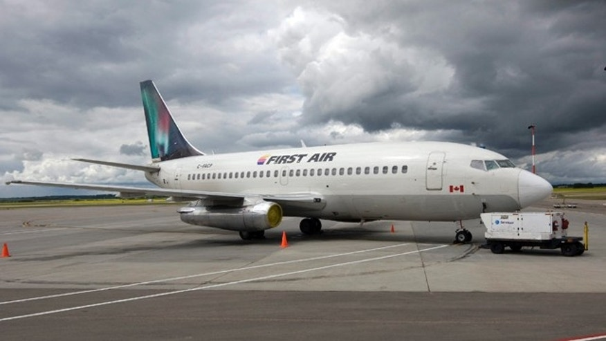 In this July 15, 2009, photo, a Boeing 737 (737-200) jetliner is seen in Edmonton, Canada. A Boeing 737 operated by First Air crashed near Resolute Bay, Nunavut, killing 12 people on Saturday, Aug. 20, 2011, in Canada.