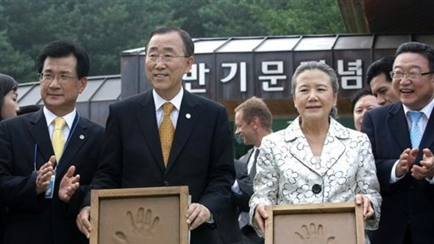 August 14: U.N. Secretary-General Ban Ki-moon  and his wife, Yoo Soon-taek, show their hand prints during his visit to his hometown in Eumseong, South Korea.