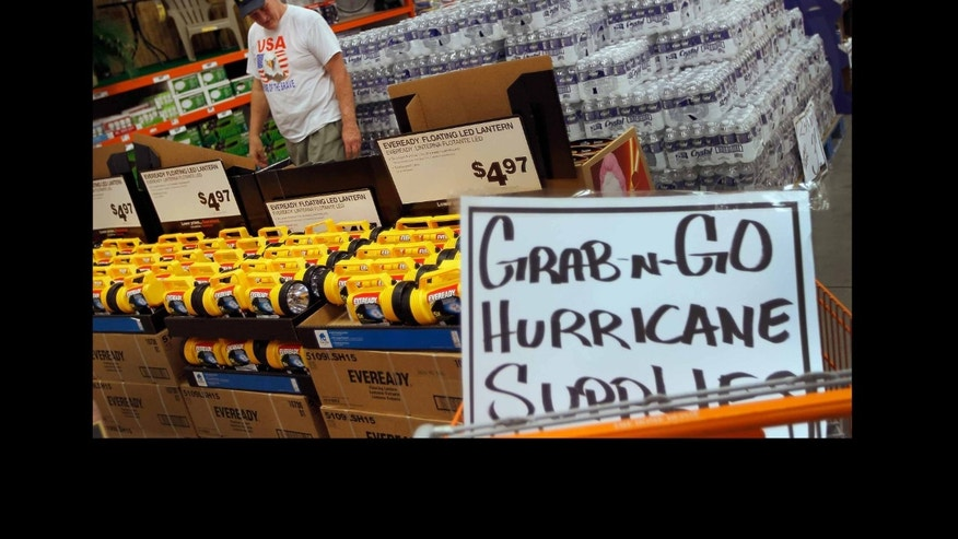 WEST PALM BEACH, FL - AUGUST 22:  Jim Abel shops for hurricane supplies at Home Depot as he prepares for the possible arrival of Hurricane Irene on August 22, 2011 in West Palm Beach, Florida. Irene is the first Hurricane of the 2011 Atlantic season with winds at 80mph currently and may hit the East coast later this week with higher winds projected.  (Photo by Joe Raedle/Getty Images)