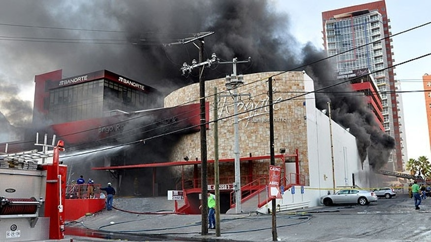 August 25: Smoke billows from the Casino Royale in Monterrey, Mexico.