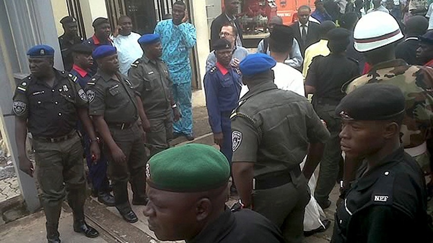 Aug. 26: This image released by Saharareporters shows police and rescue workers after a large explosion struck the United Nations' main office in Nigeria's capital Abuja, flattening one wing of the building and killing several people. A U.N. official in Geneva called it a bomb attack. The building, located in the same neighborhood as the U.S. embassy and other diplomatic posts in Abuja, had a huge hole punched in it.