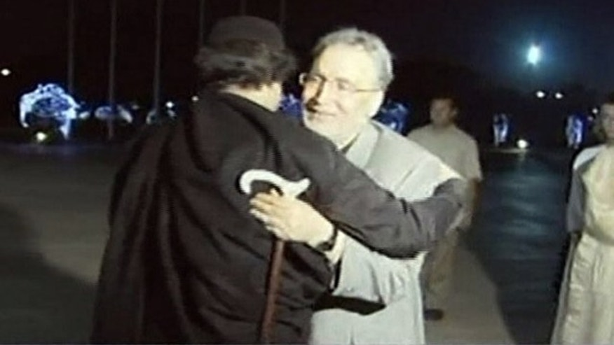 Aug. 21, 2009: In this image made from television, Abdel Baset al-Megrahi, right, who was found guilty of the 1988 Lockerbie bombing, is greeted by Libyan leader Muammar al-Qaddafi in Tripoli, Libya.