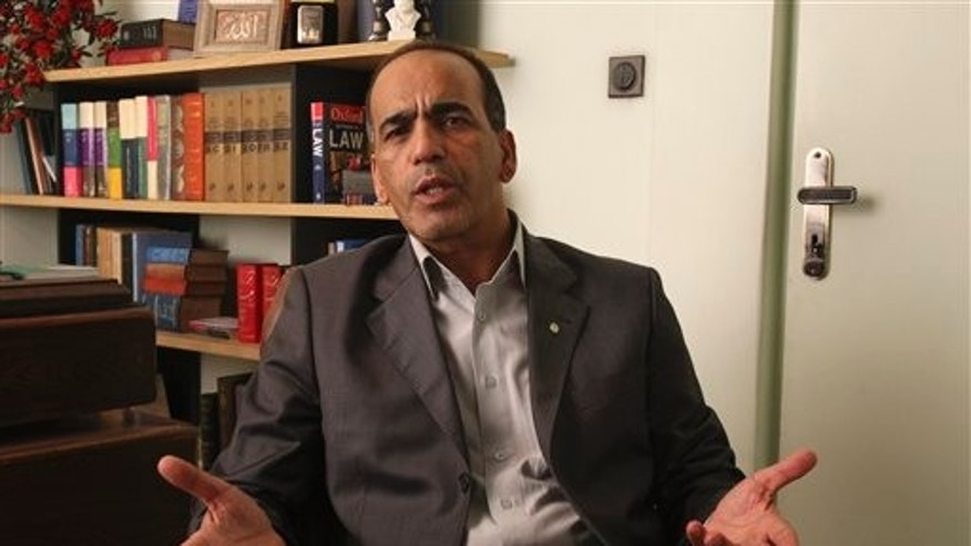 July 30: Masoud Shafiei, the Iranian lawyer for two Americans who have been jailed in Iran on charges of espionage, speaks at his office in Tehran, Iran.
