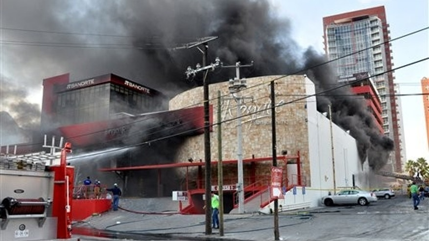 Smoke billows from the Casino Royale in Monterrey, Mexico, Thursday Aug. 25, 2011. Two dozen gunmen burst into the casino in northern Mexico on Thursday, doused it with a flammable liquid and started a fire that trapped gamblers inside, killing at least 32 people and injuring a dozen more, authorities said. (AP Photo)