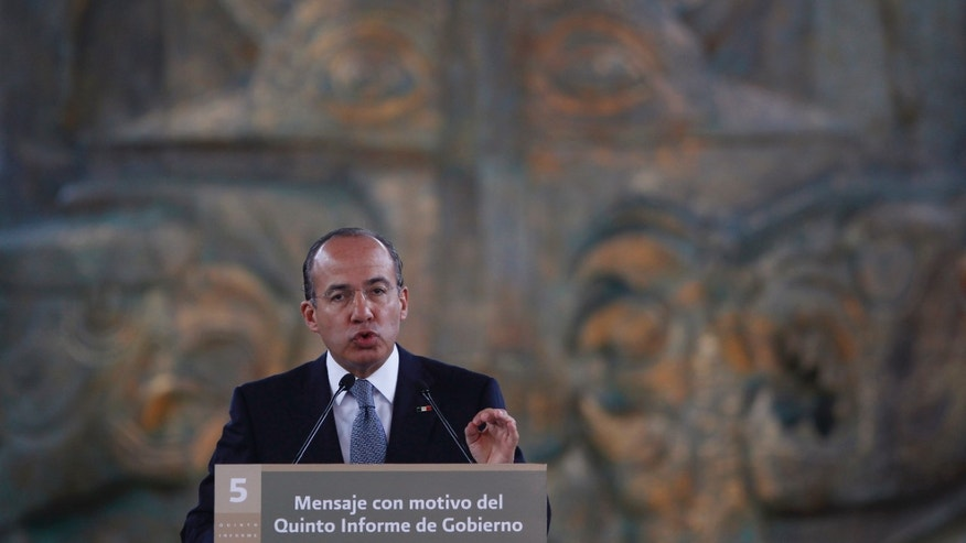 "Mexico's President Felipe Calderon gives his state of the nation address at the National Museum of Anthropology in Mexico City, Friday Sept. 2, 2011. The sign reads in Spanish ""Message for the occasion of the fifth government report."""