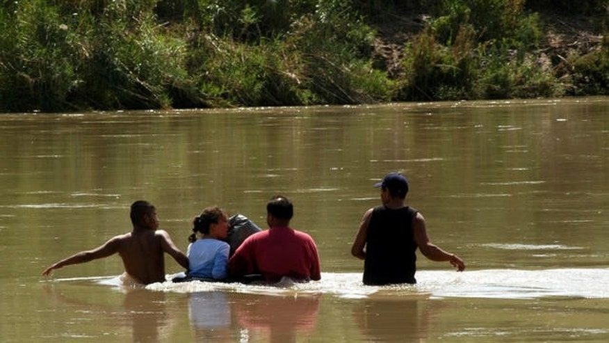 Unidentified migrants, who did not wish to give their names, from Mexico, cross the waters of the Rio Grande, with the help of smugglers, in an attempt to reach the U.S. border. On Friday, a jury found a Homeland Security pilot not guilty of lying about his role in the 2005 drowning of a Mexican man who was swimming across the Rio Grande towards Texas.