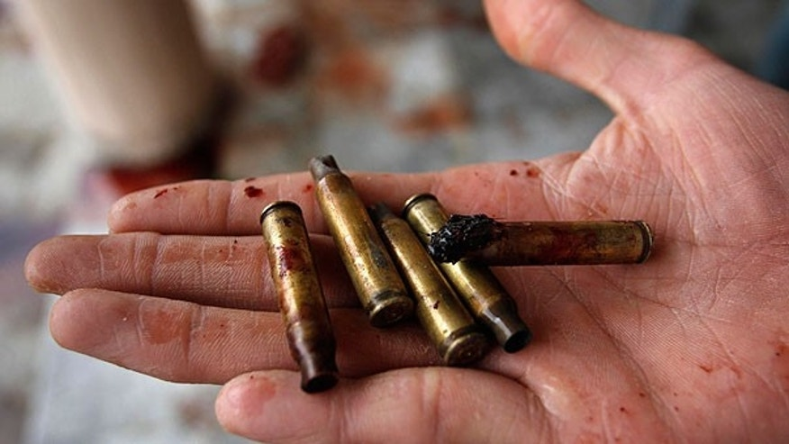Sept. 3: An Afghan man displays some of the used bullets at the scene where Sabar Lal Melma, a former Guantanamo detainee was allegedly killed in a NATO and Afghan forces raid in Jalalabad, Nangarhar province, east of Kabul, Afghanistan.