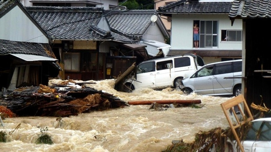 Sept. 4: Overflowing water from a river floods a residential area in Nachikatsuura, central Japan. The center of the season's 12th typhoon was moving slowly north across the Sea of Japan, the Japan Meteorological Agency said.