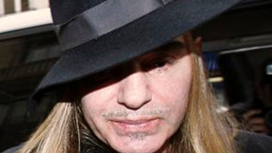 In this Feb. 28, 2011 file photo, fashion designer John Galliano arrives at a police station in Paris.