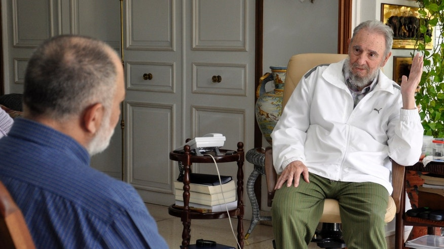 "Cuba's former President Fidel Castro, right, speaks during an interview with Mario Silva, a journalist from Venezolana de Television, in Havana, Cuba. In Venezuela, Silva showed a collection of photos from his interview of Castro on his program ""La Hojilla,"" or ""The Razor."""