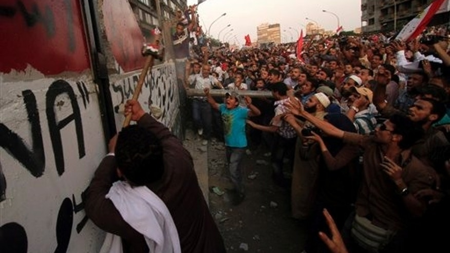 Sept. 9: Egyptians demolish a concrete wall built around a building housing the Israeli Embassy in Cairo, to protect it against demonstrators