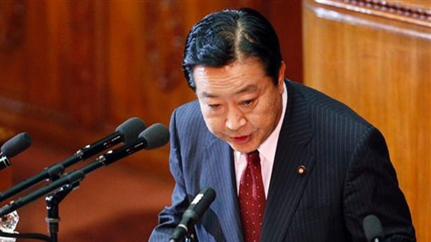 Japan's new Prime Minister Yoshihiko Noda delivers his policy speech during an extraordinary Diet session in Tokyo, Tuesday, Sept. 13, 2011.
