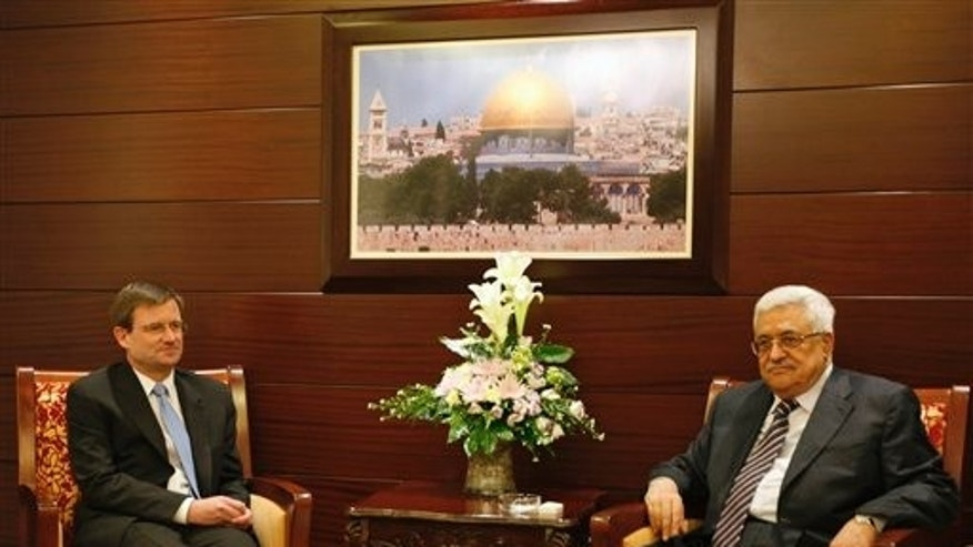 September 7: Senior White House envoy David Hale, left, sits with Palestinian President Mahmoud Abbas during their meeting at Abbas's headquarters in the West Bank city of Ramallah.