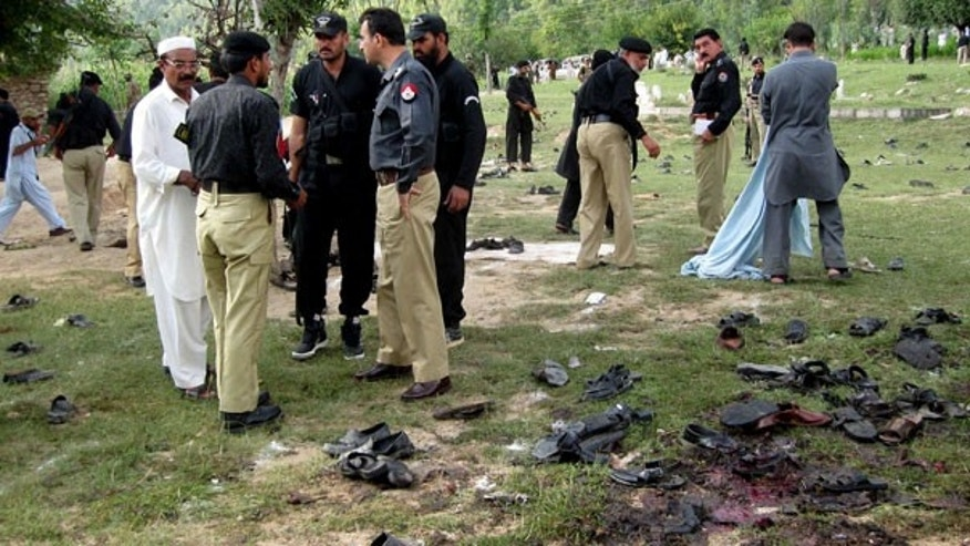 Sept. 15: Pakistani police officers visit the site of a suicide bombing in Shina Samar Bagh in Lower Dir, Pakistan.